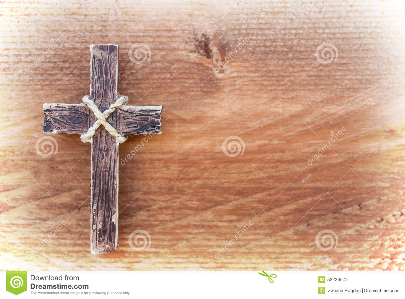 Hanging Wooden Cross On Old Wood Background Stock Photo