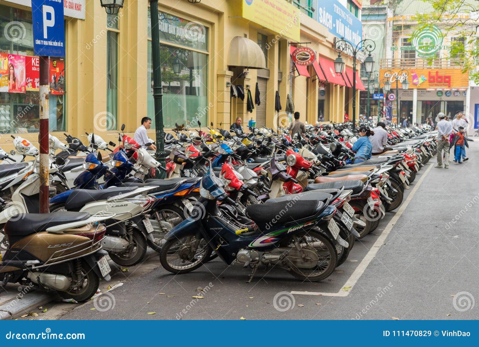 Hanoi, Vietnam - Mar 15, 2015: The parking of motorbikes on street in Trang Tien street. Hanoi lacks of parking area for motorbike