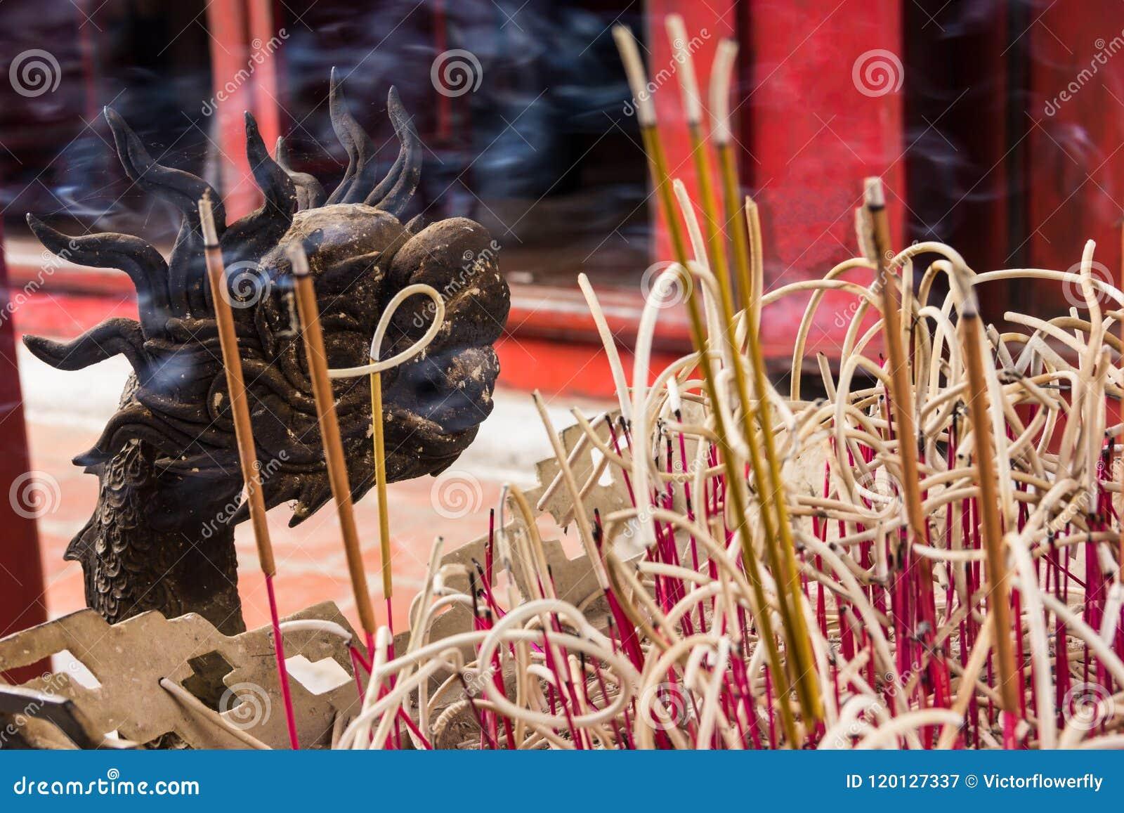 Hanoi, Vietnam - October 21, 2017: detailed decorative pattern of dragon Joss stick incense pot inside the Temple of Literature