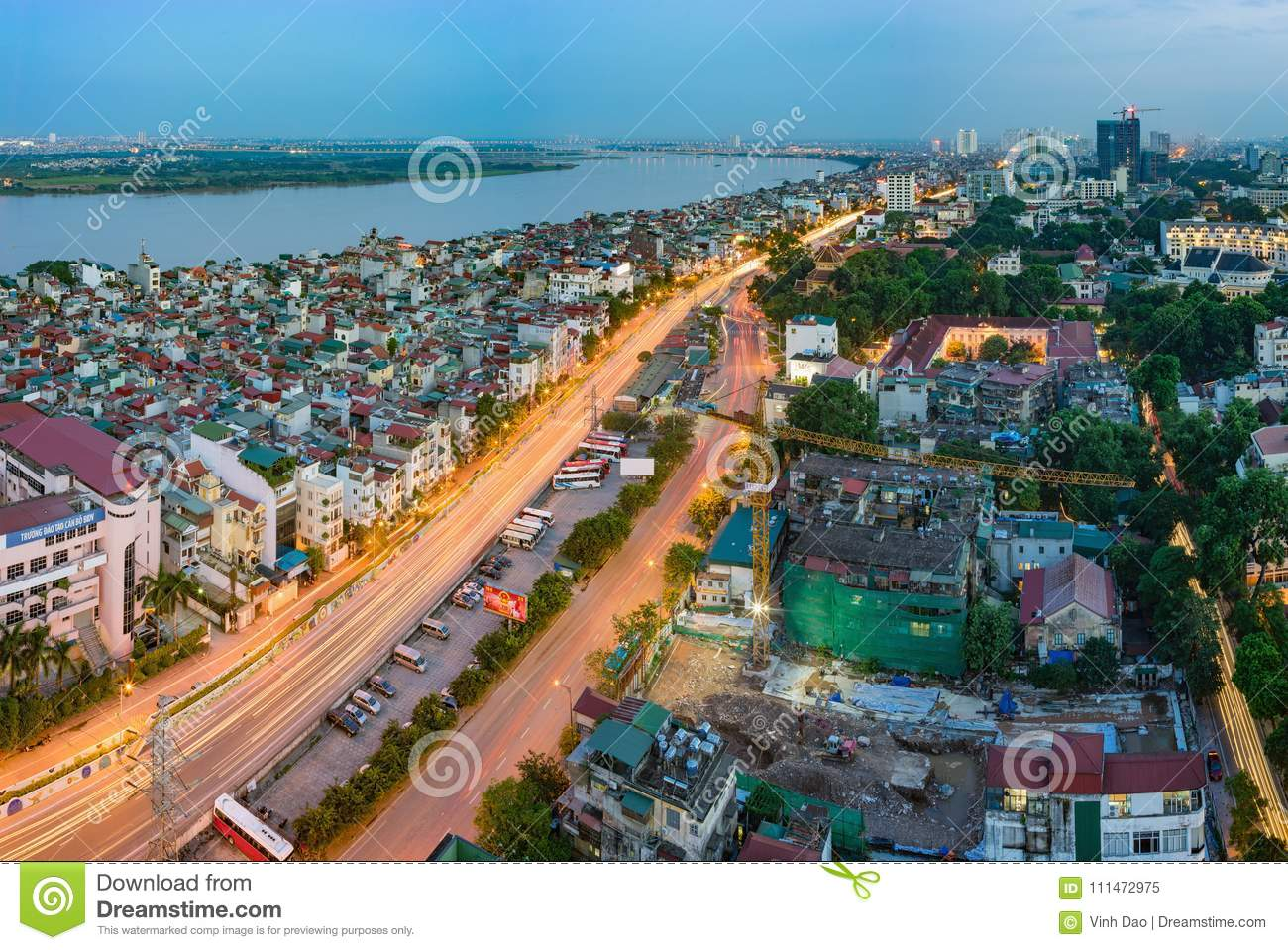 Hanoi, Vietnam - Sep 19, 2015: Aerial skyline view of Nguyen Khoai street with Vinh Tuy bridge crossing Red River on background. H
