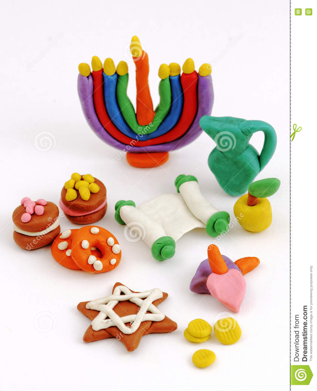 Hanukkah handmade plasticine toys. Modeling clay colorful texture. Isolated on white background