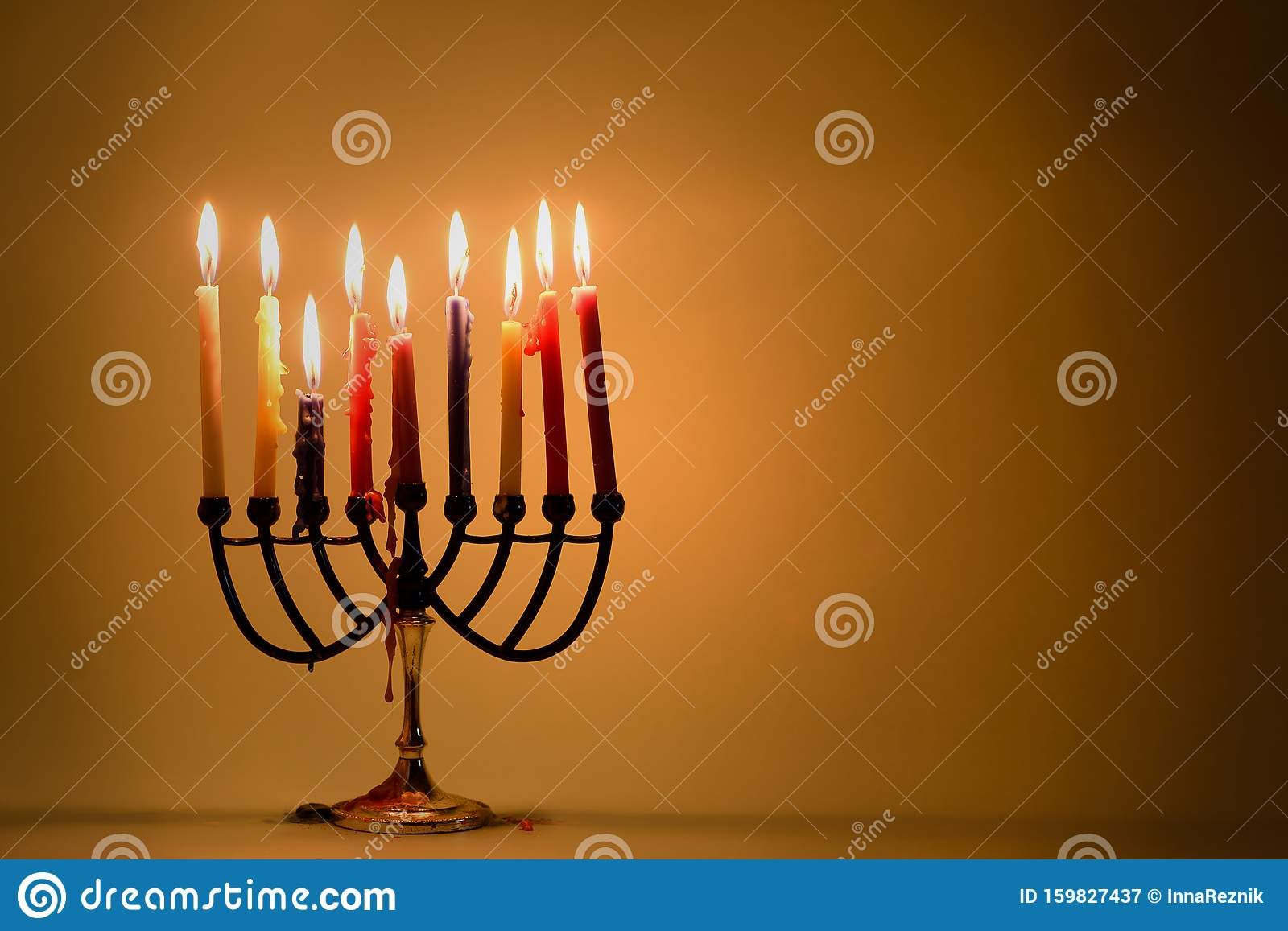 Hanukkah: Holiday Menorah With Variety Of Colorful Lit Candles.