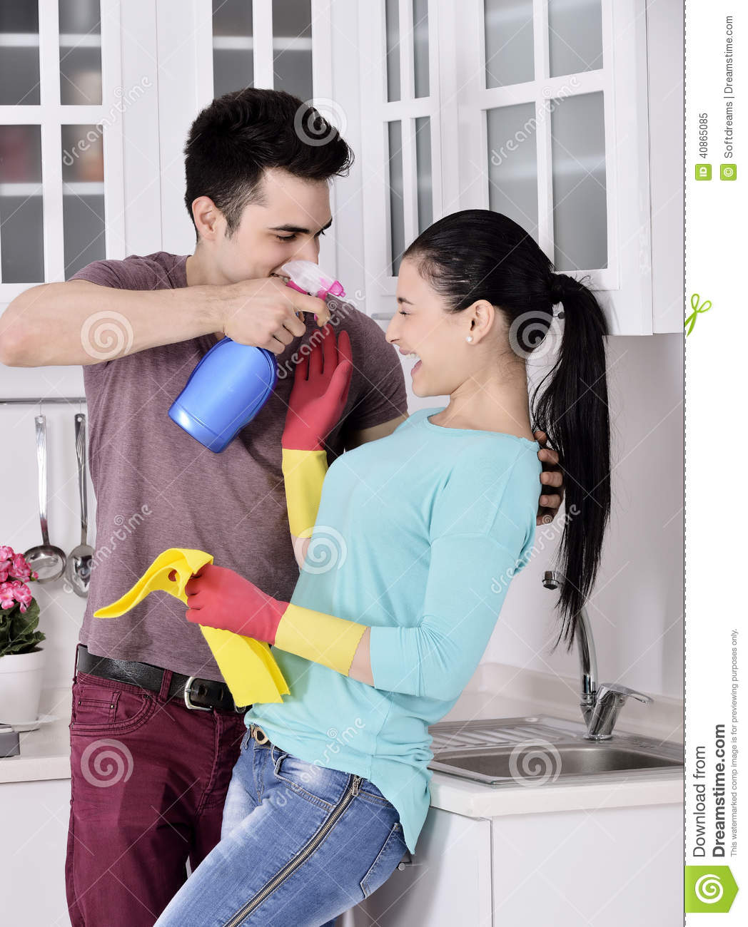 Happy Girl Kitchen: Happiness Couple After Cleaning The House Royalty-Free