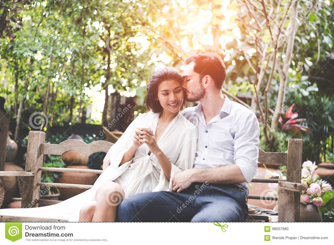 Happiness and romantic scene of love asian couples partners making eye contact and kiss