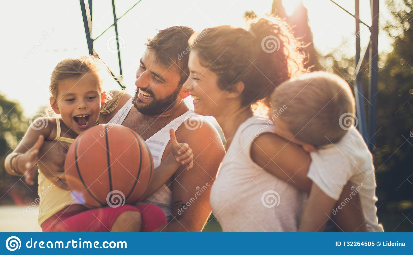 27145c972292 Happiness is in small things if you know how to value them. Family on  basketball court. Close up