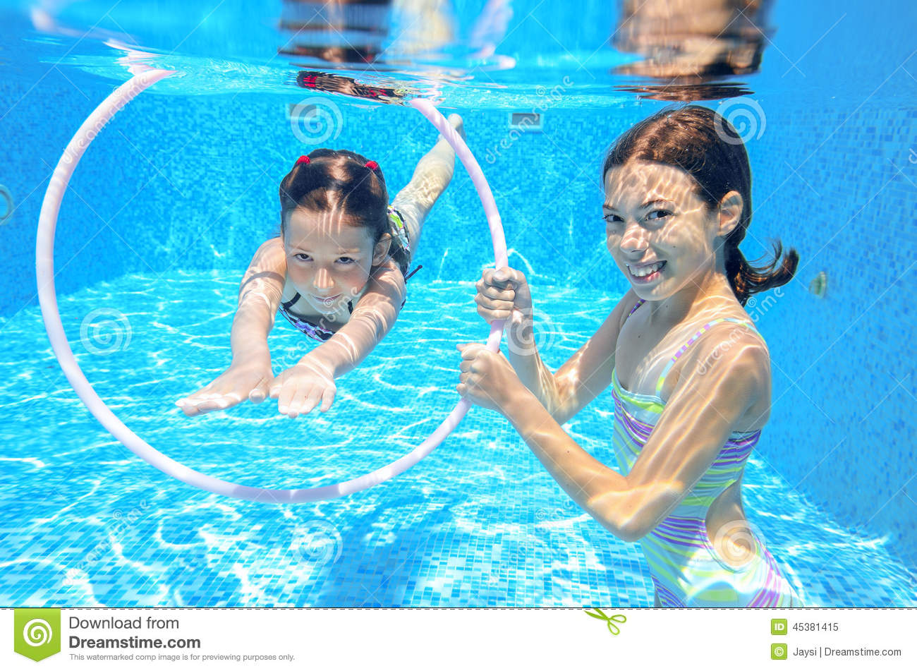 Happy Active Kids Swim In Pool And Play Underwater Stock ...