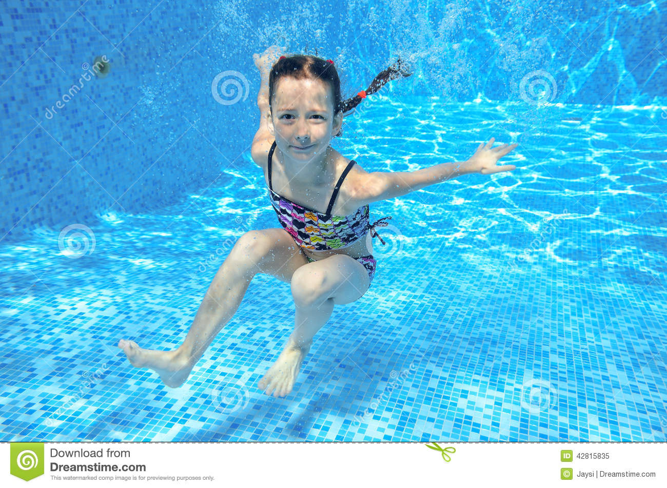 Happy Active Underwater Child Swims In Pool, Beautiful ...