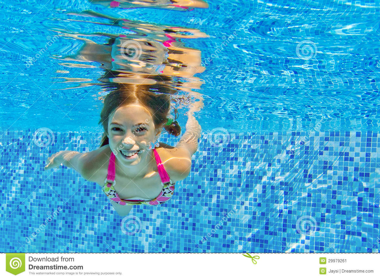 Happy Active Underwater Child Swims And Dives In Pool ...