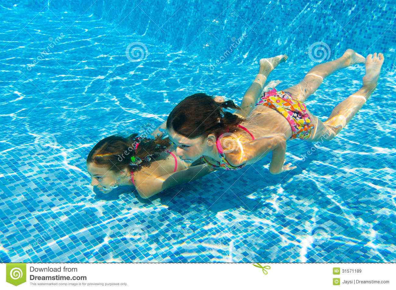 Kids Swimming Underwater happy active underwater children swim in pool royalty free stock