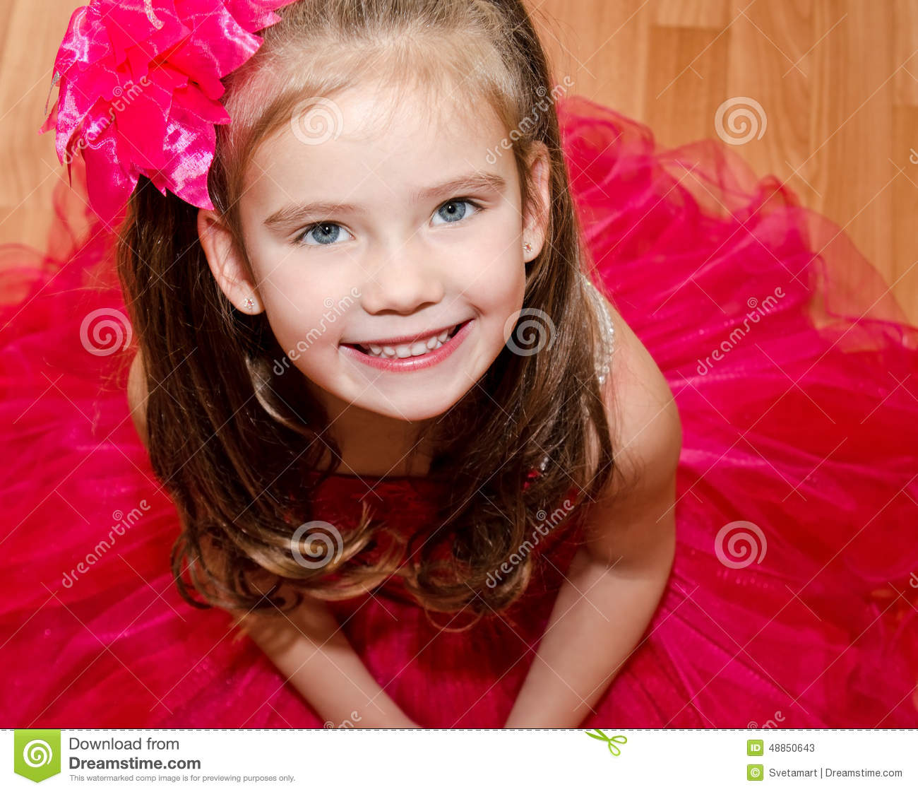 Happy Adorable Little Girl In Princess Dress Stock Photo
