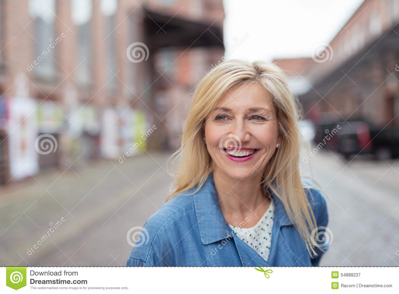 Happy Adult Blond Woman Laughing at the Street