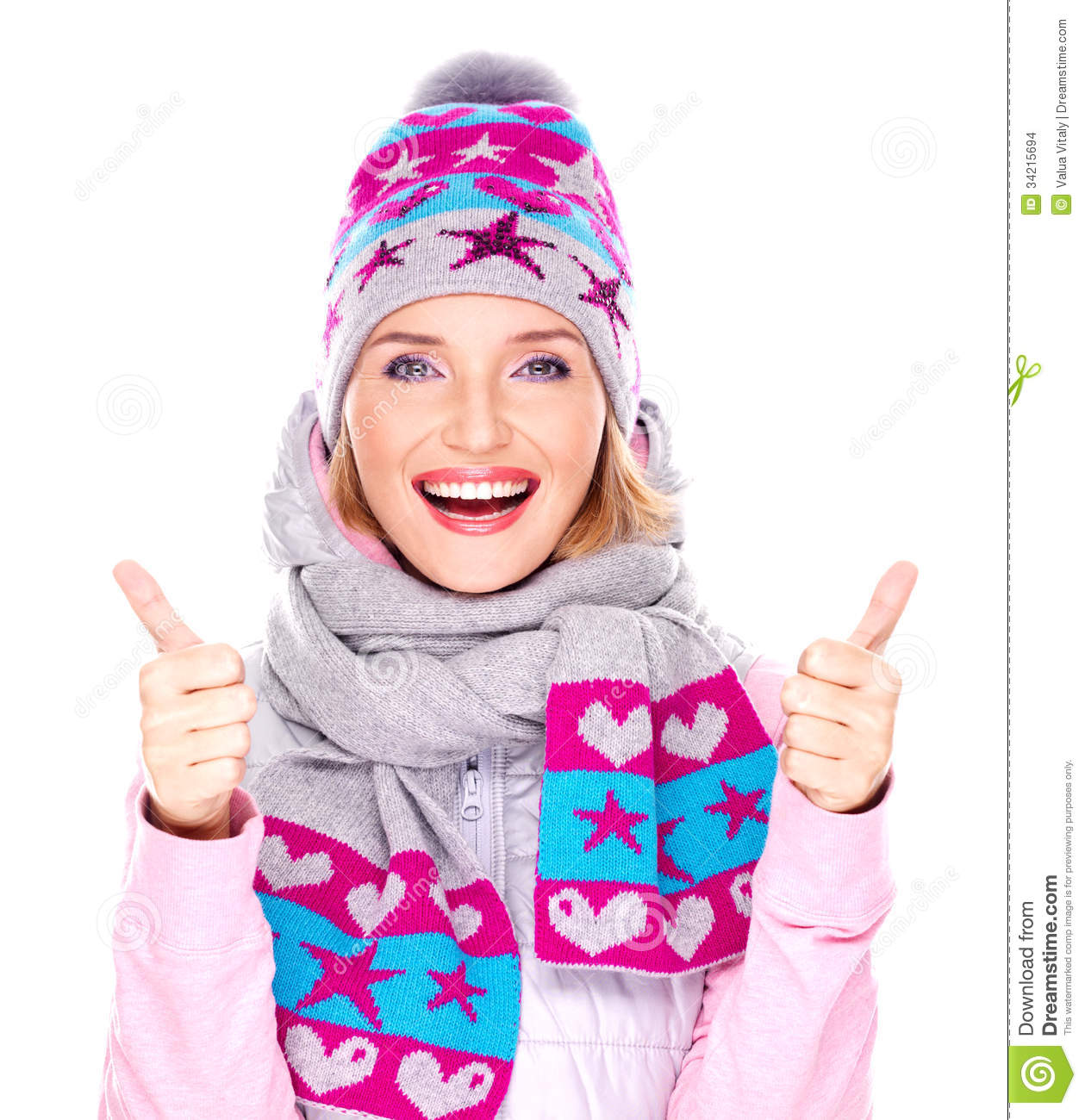Happy adult girl in winter clothes with thumbs up