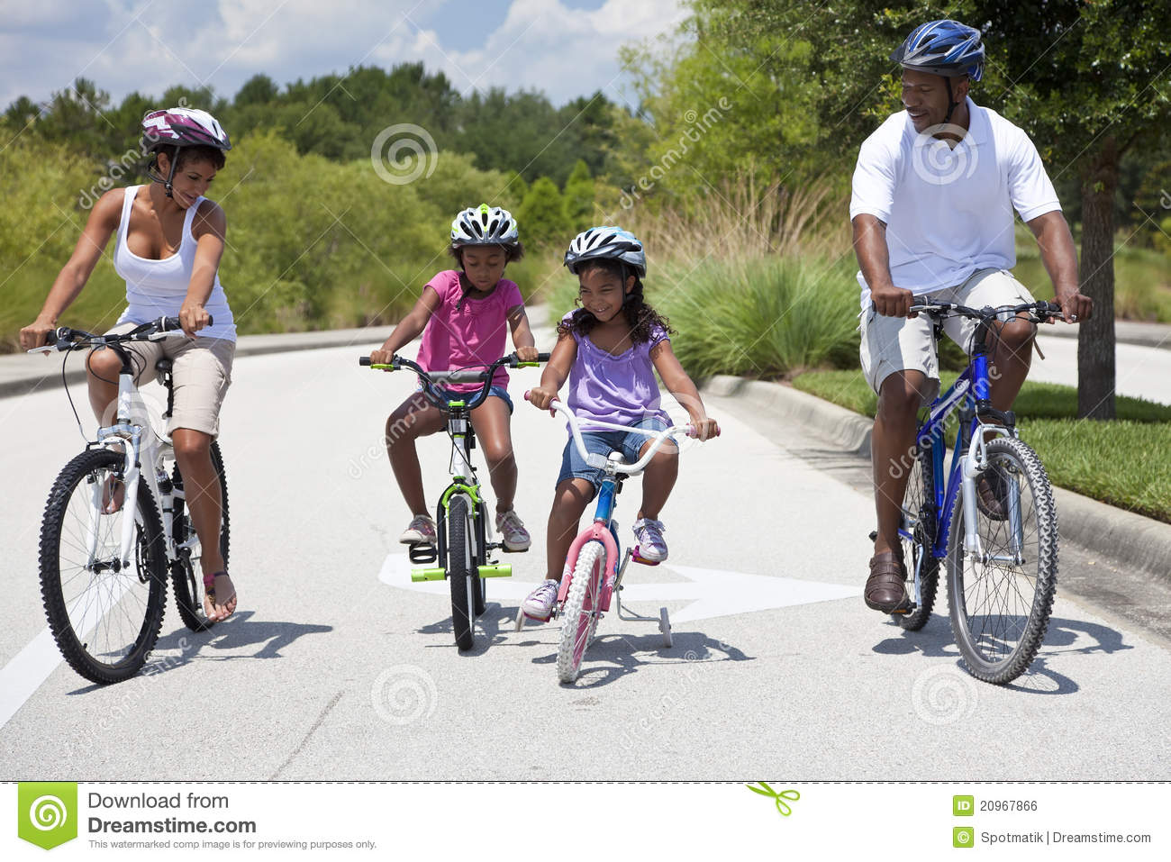Happy African American Family Riding Bikes