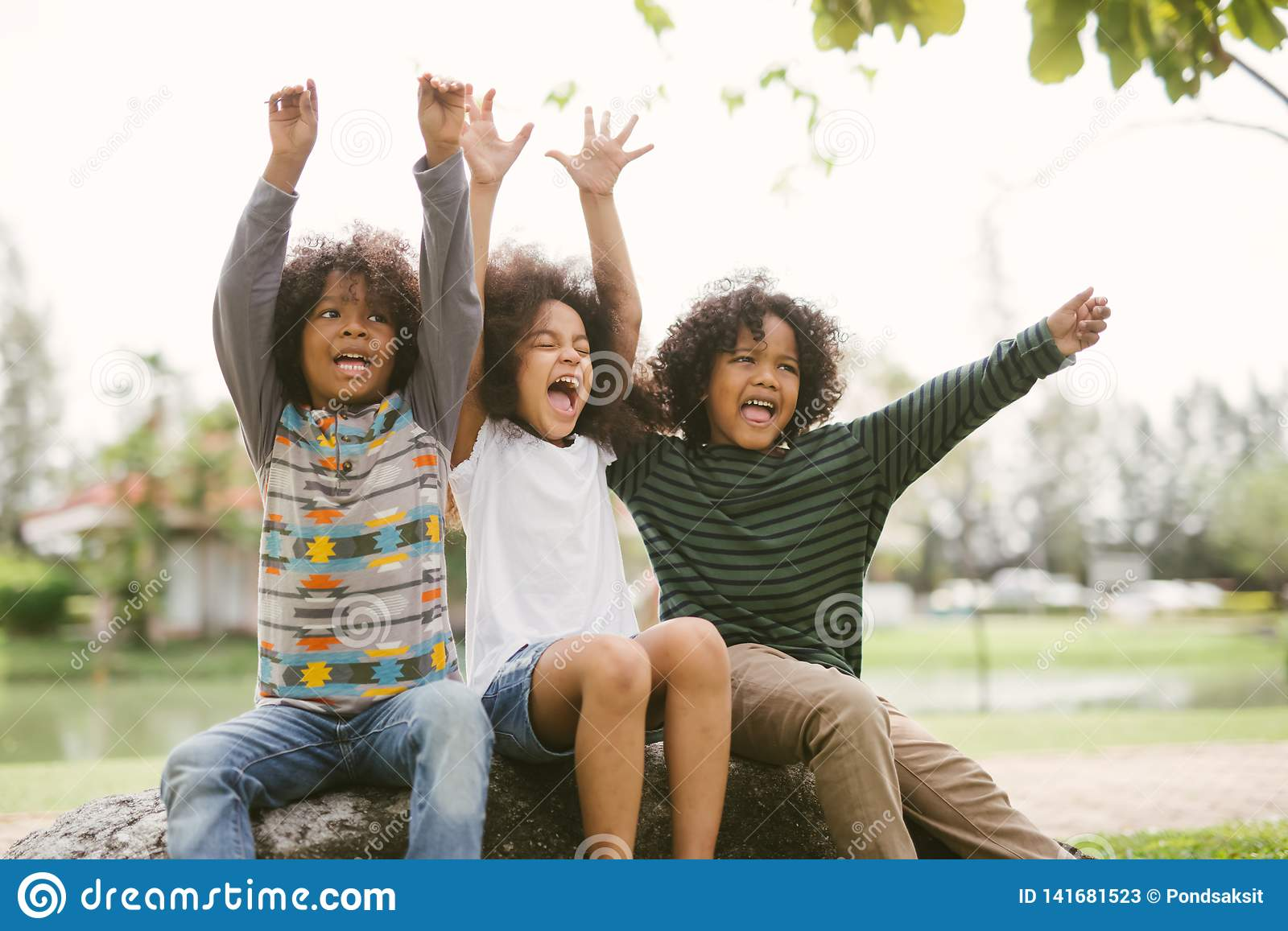 Happy African american little boy kids children joyfully cheerful and laughing. Concept of happiness.