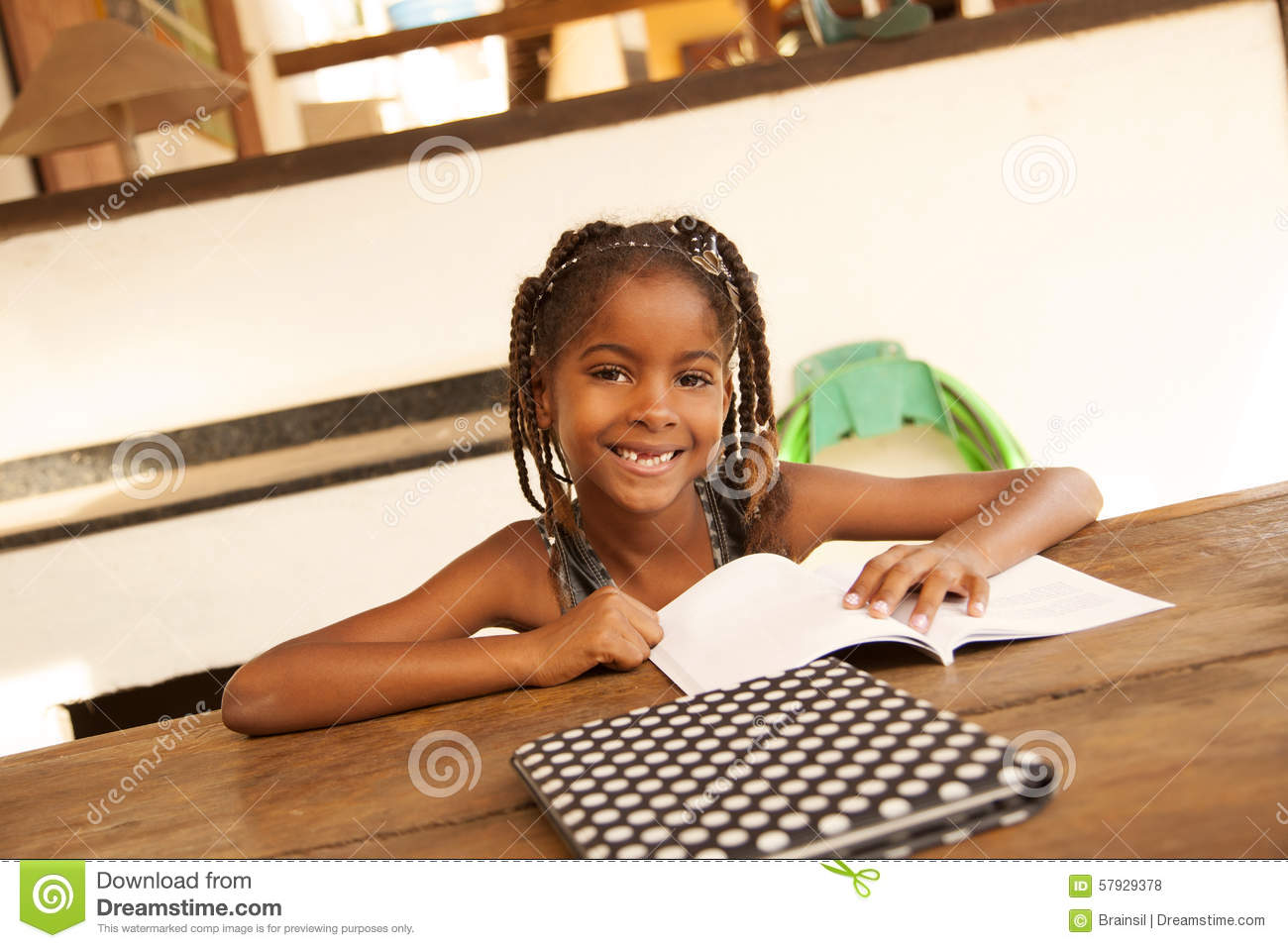 Happy african american little girl studying
