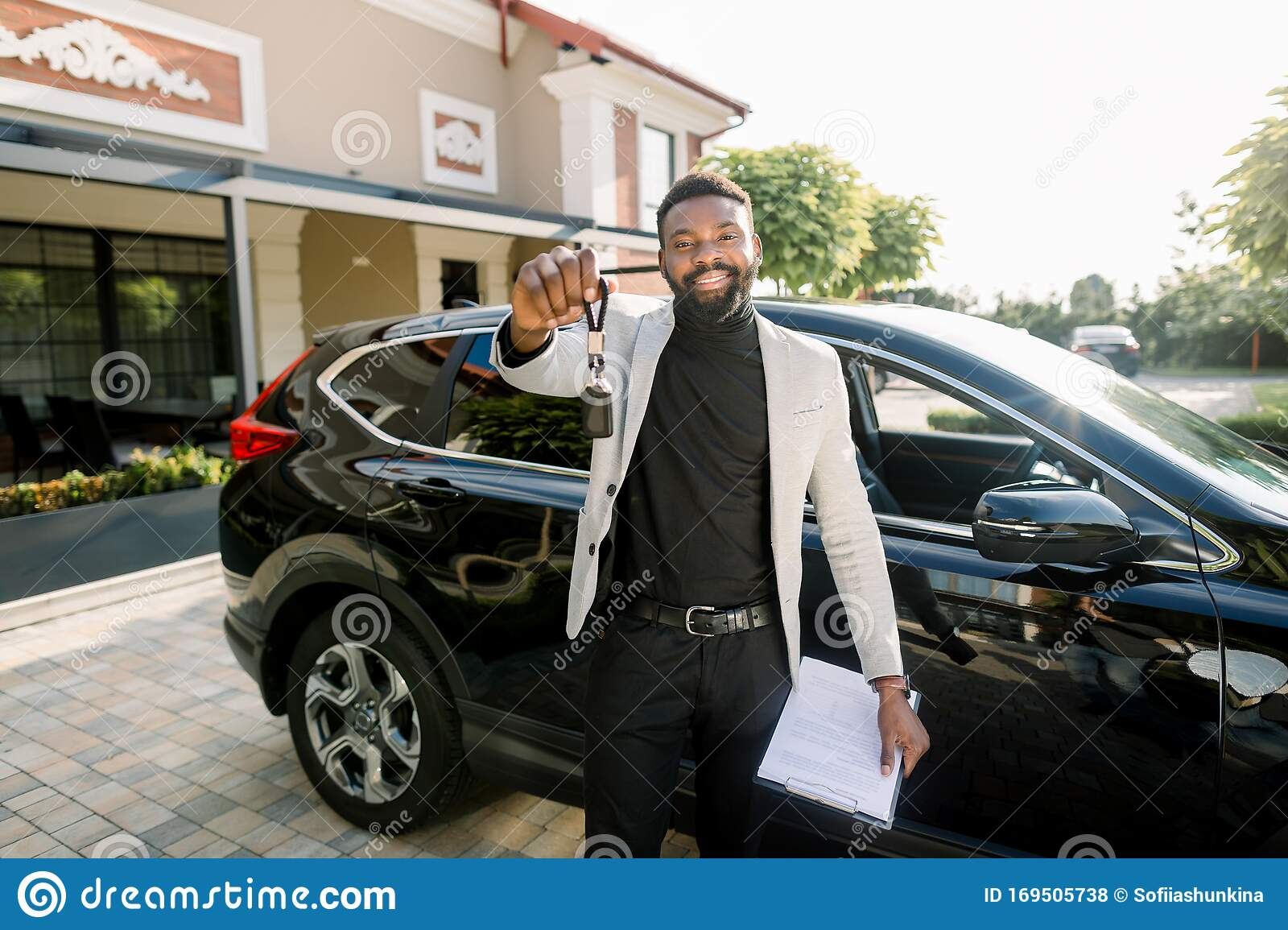 Happy African American Man Showing Car Key Standing Near New Black Car Crossover Outdoors Young African American Stock Photo Image Of Luxury Approved 169505738