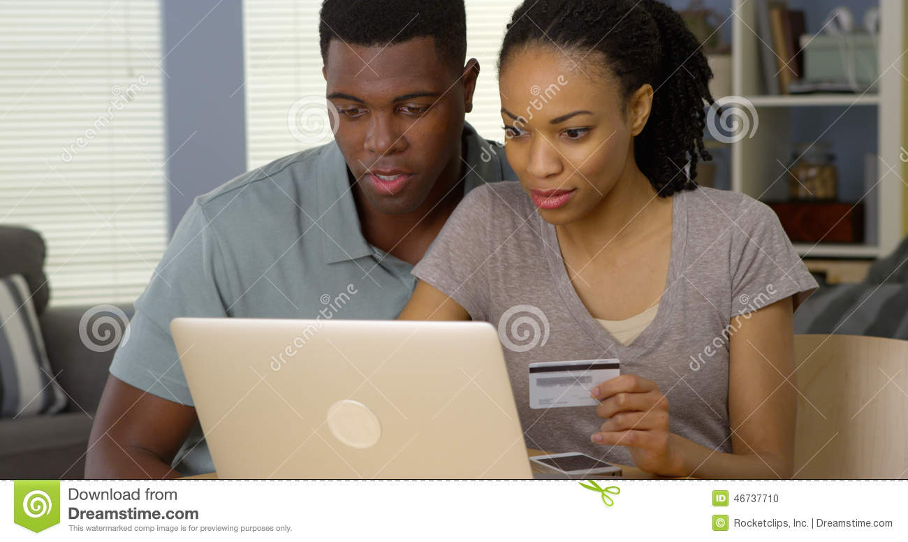 happy african american man and woman making online purchase with credit card stock photo image. Black Bedroom Furniture Sets. Home Design Ideas