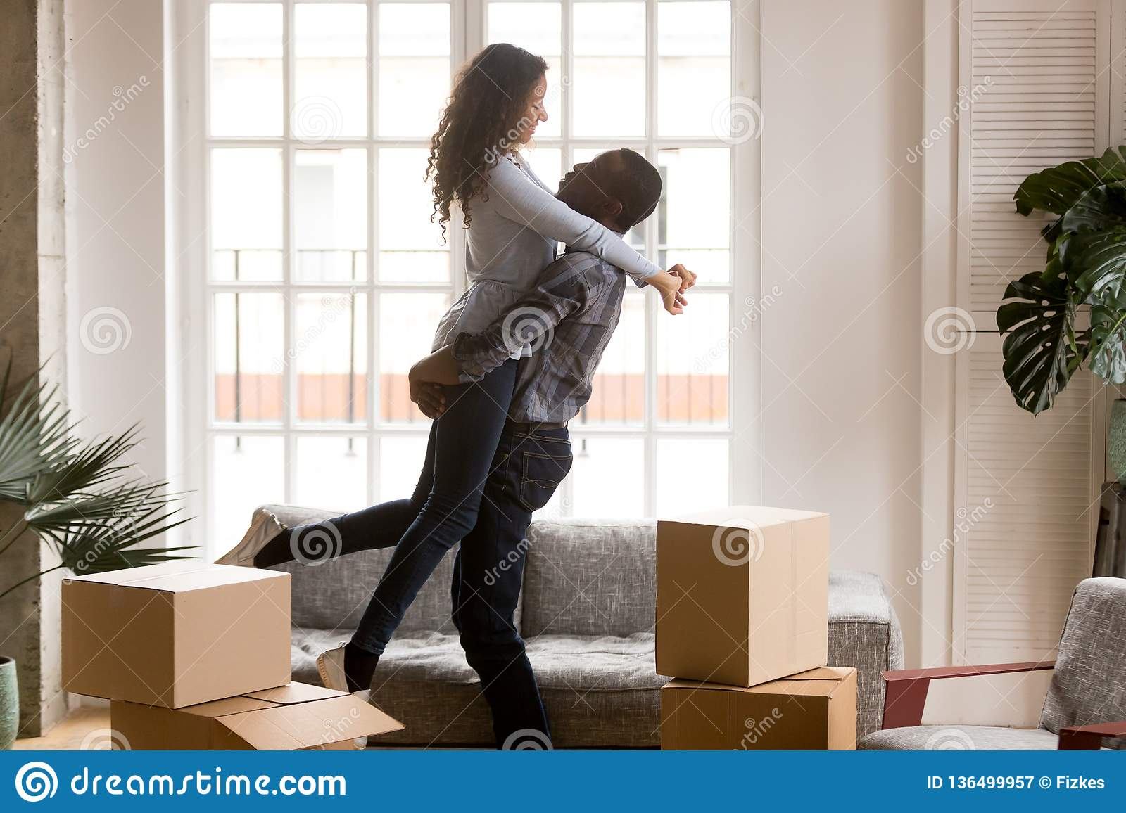 Happy african first time home buyers couple celebrating moving d