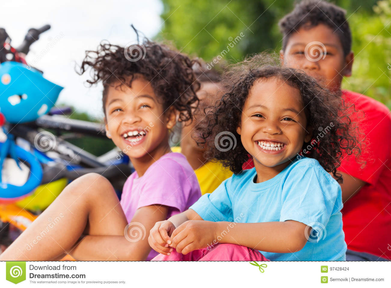 Happy African girl having fun with her friends