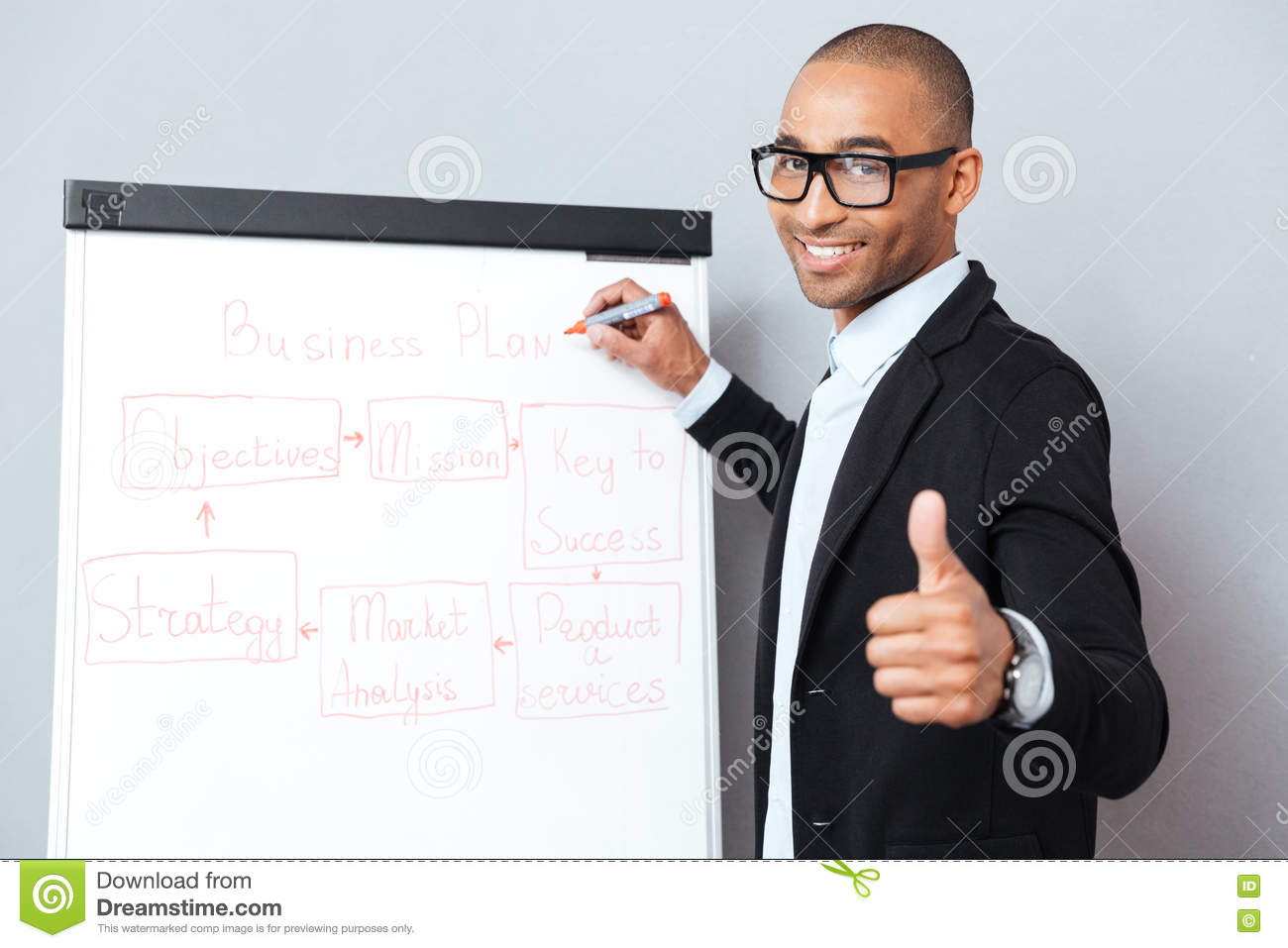 Download Happy African Man Writing On Flipchart And Showing Thumbs Up Stock Image - Image of student, profit: 72926707