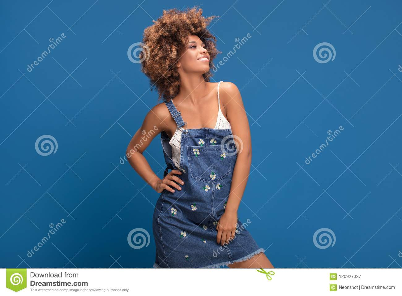 Happy Afro Girl In Jeans Dress On Blue Background Stock Image