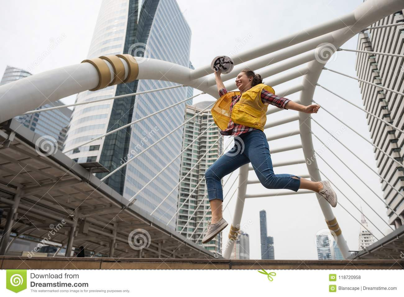 American female engineer jump in city
