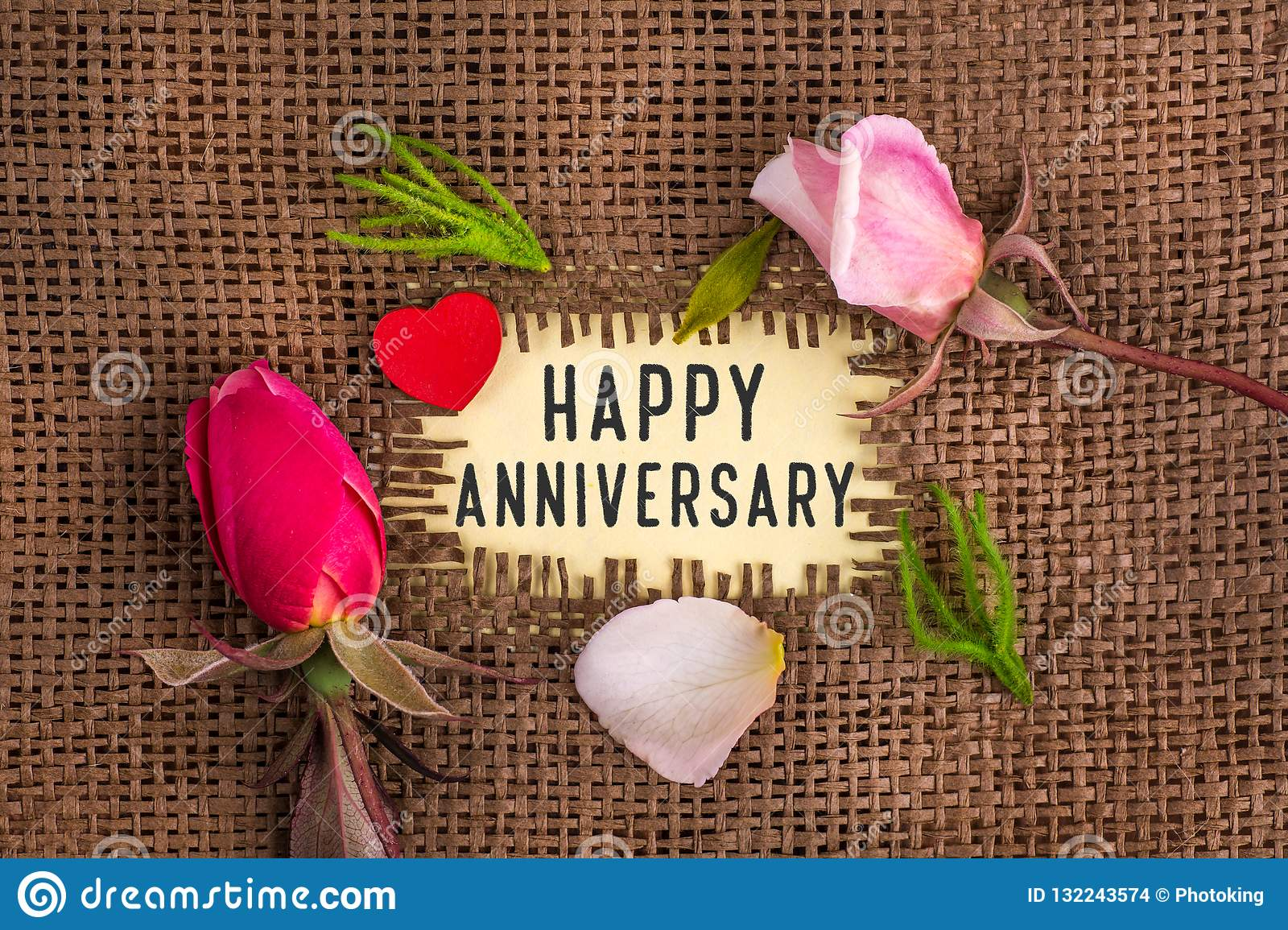 Happy anniversary written in hole on the burlap