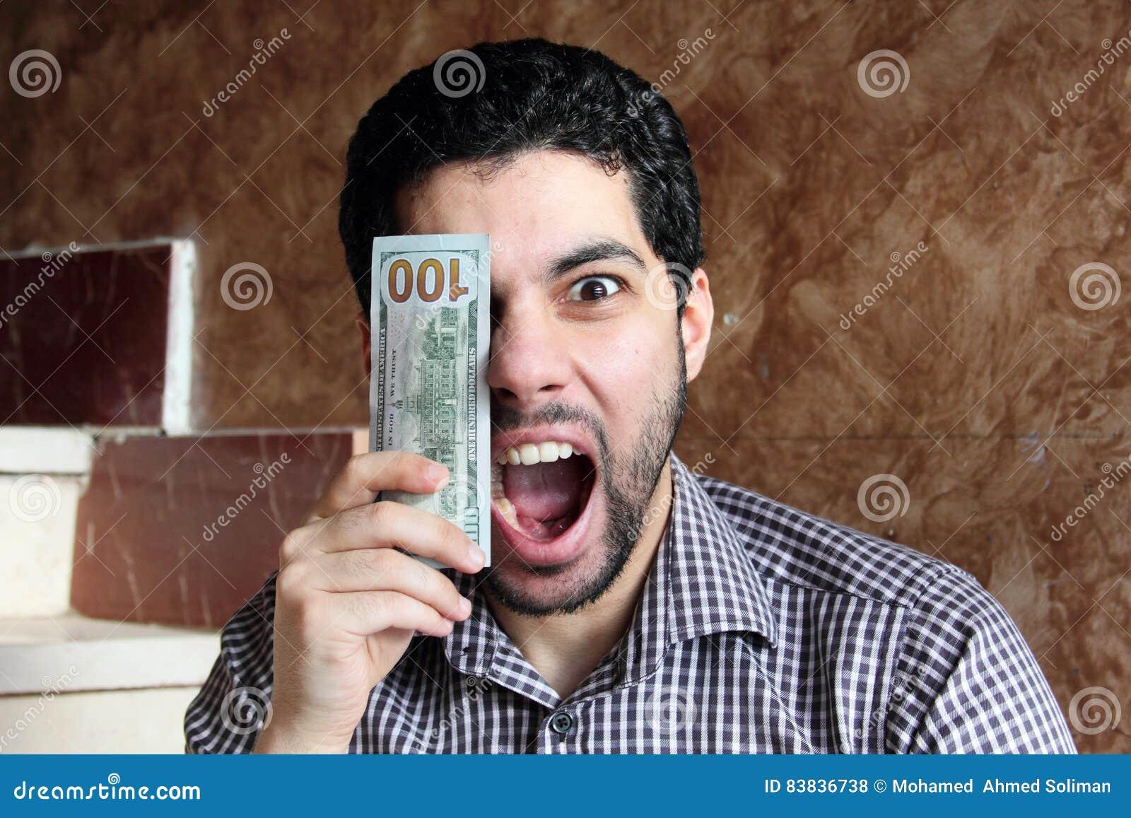 Happy arab businessman with money