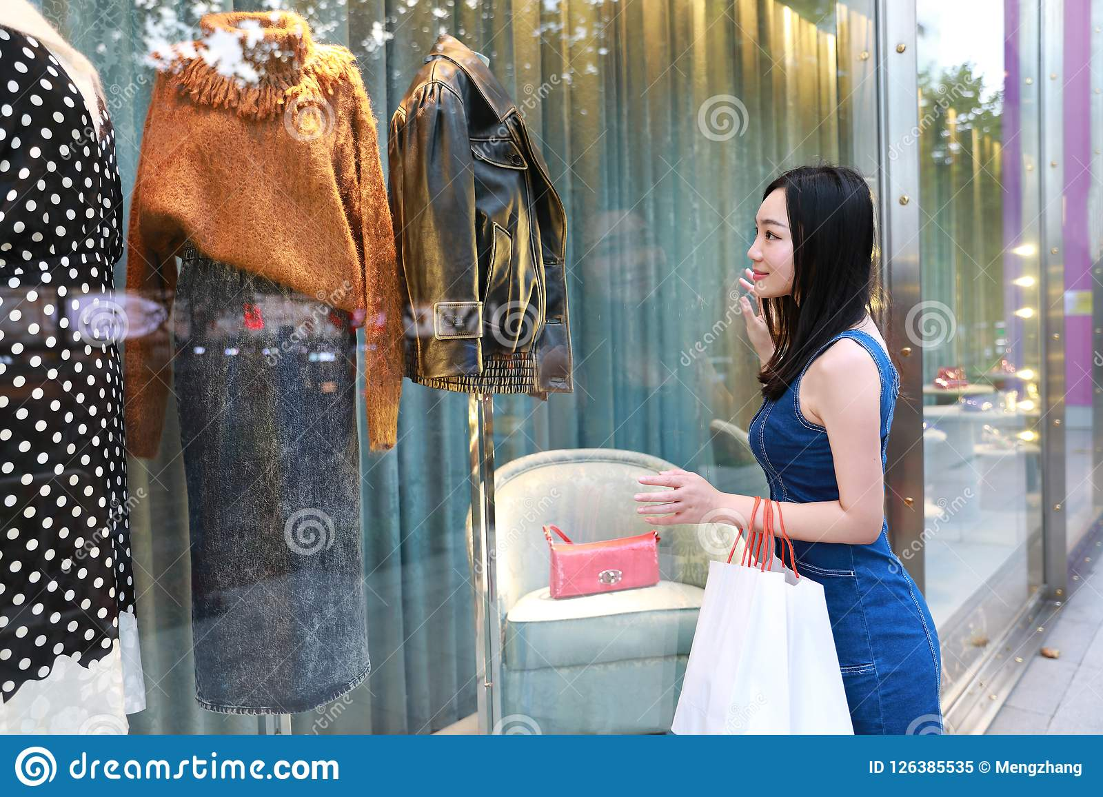Happy Asia Chinese Eastern oriental young trendy woman girl shopping in  mall with bags look at 0279d00c15