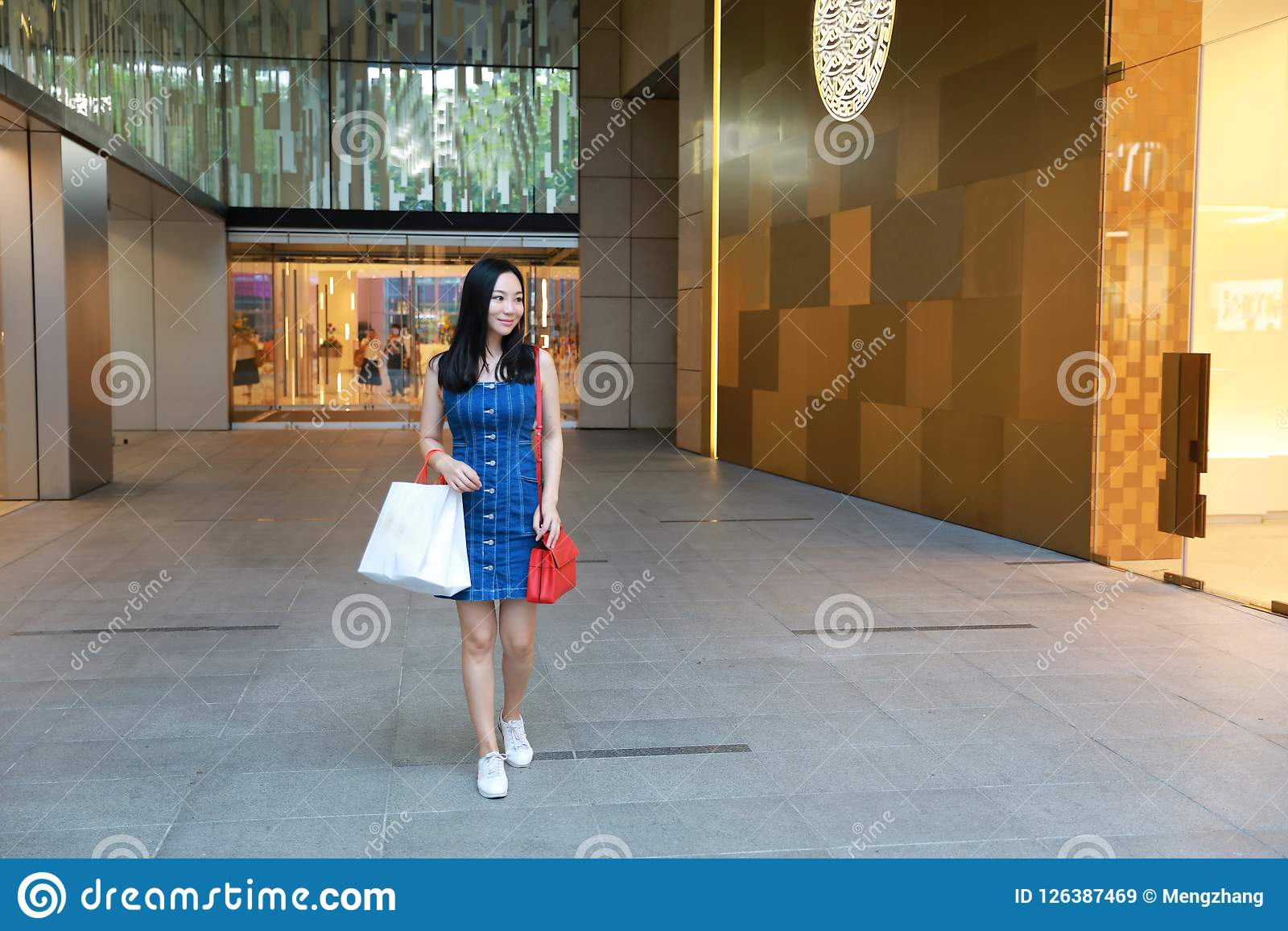 Happy Asia Chinese Eastern oriental young trendy woman girl shopping in  mall with bags shopping window 7cd67a0f7f