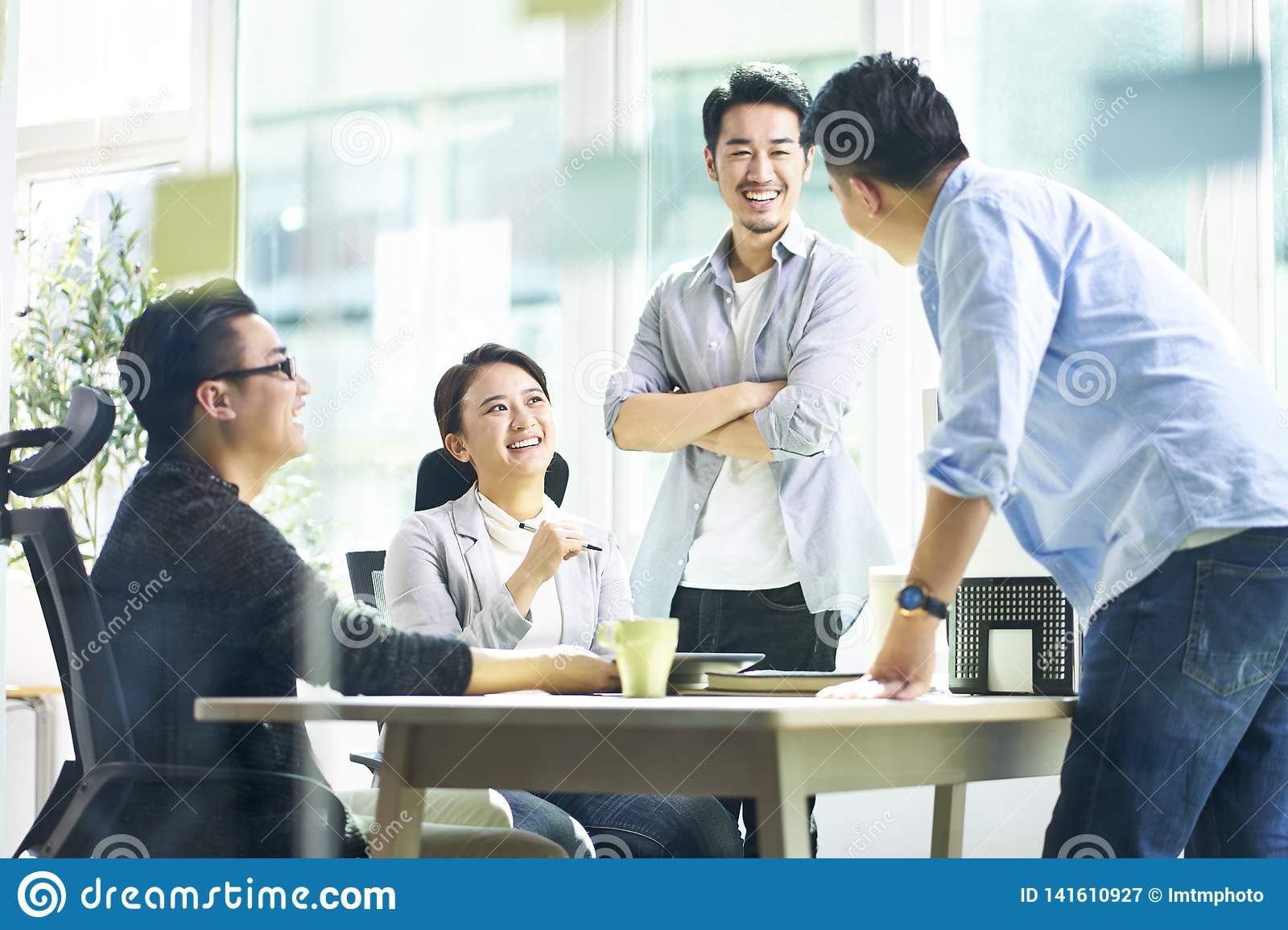 Happy asian business team meeting in office
