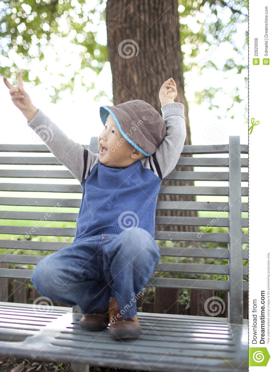 Happy Asian Child Sitting On The Garden Chair Royalty Free