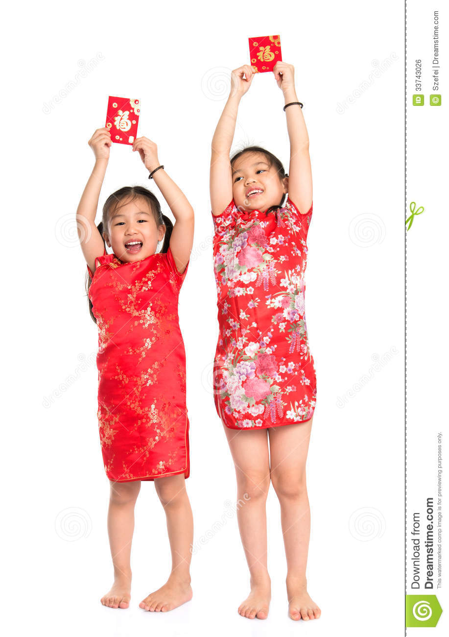 Happy Asian children holding red packet during Chinese New Year, with ...