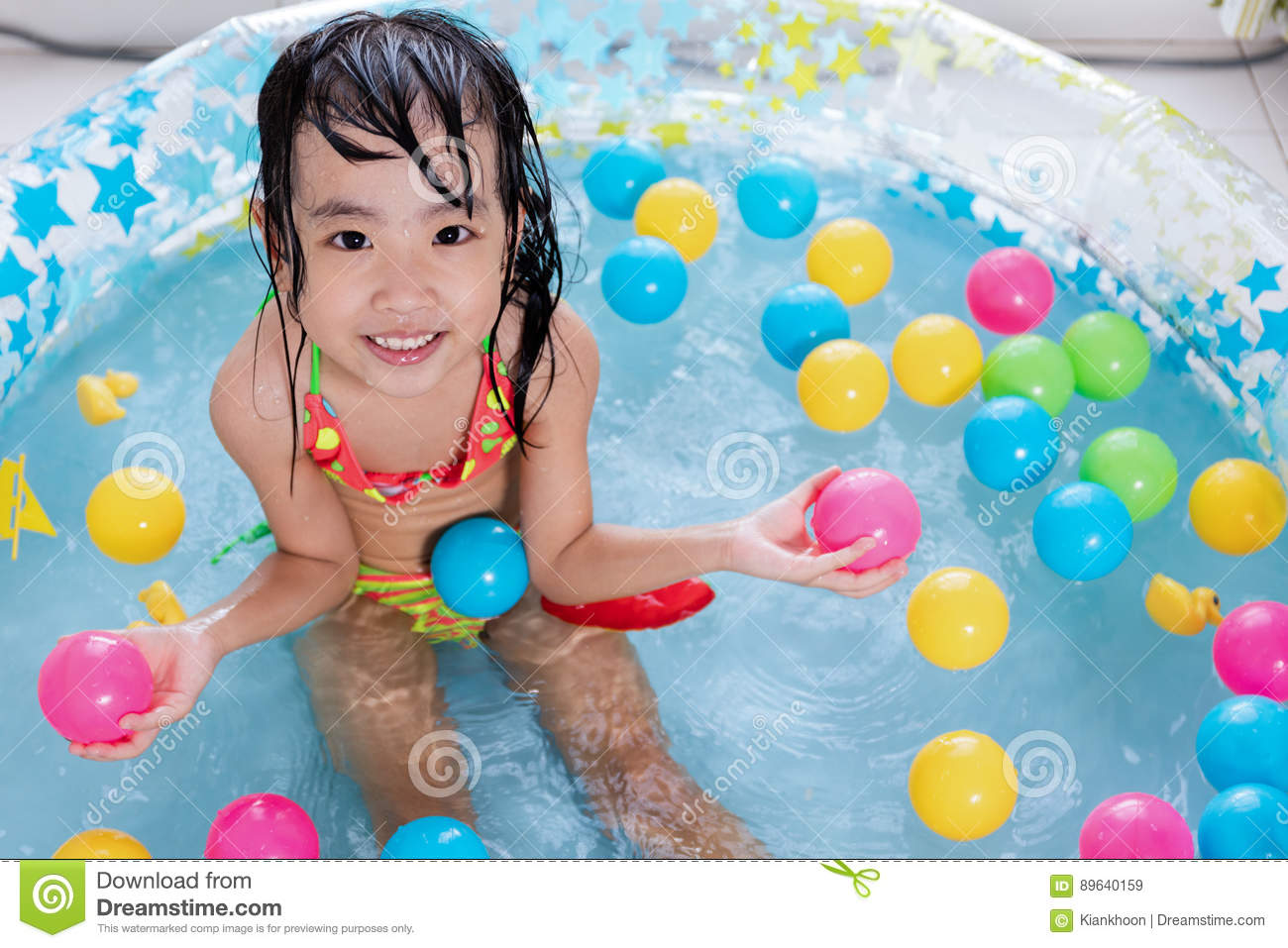 Asian Little Chinese Girls Playing In Swimming Pool Stock