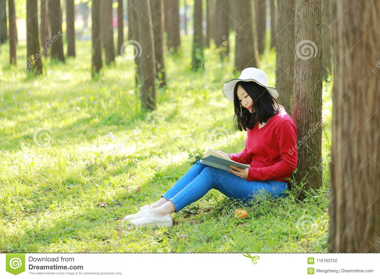 Happy Asian Chinese Woman Beauty Girl Smile And Read A Book