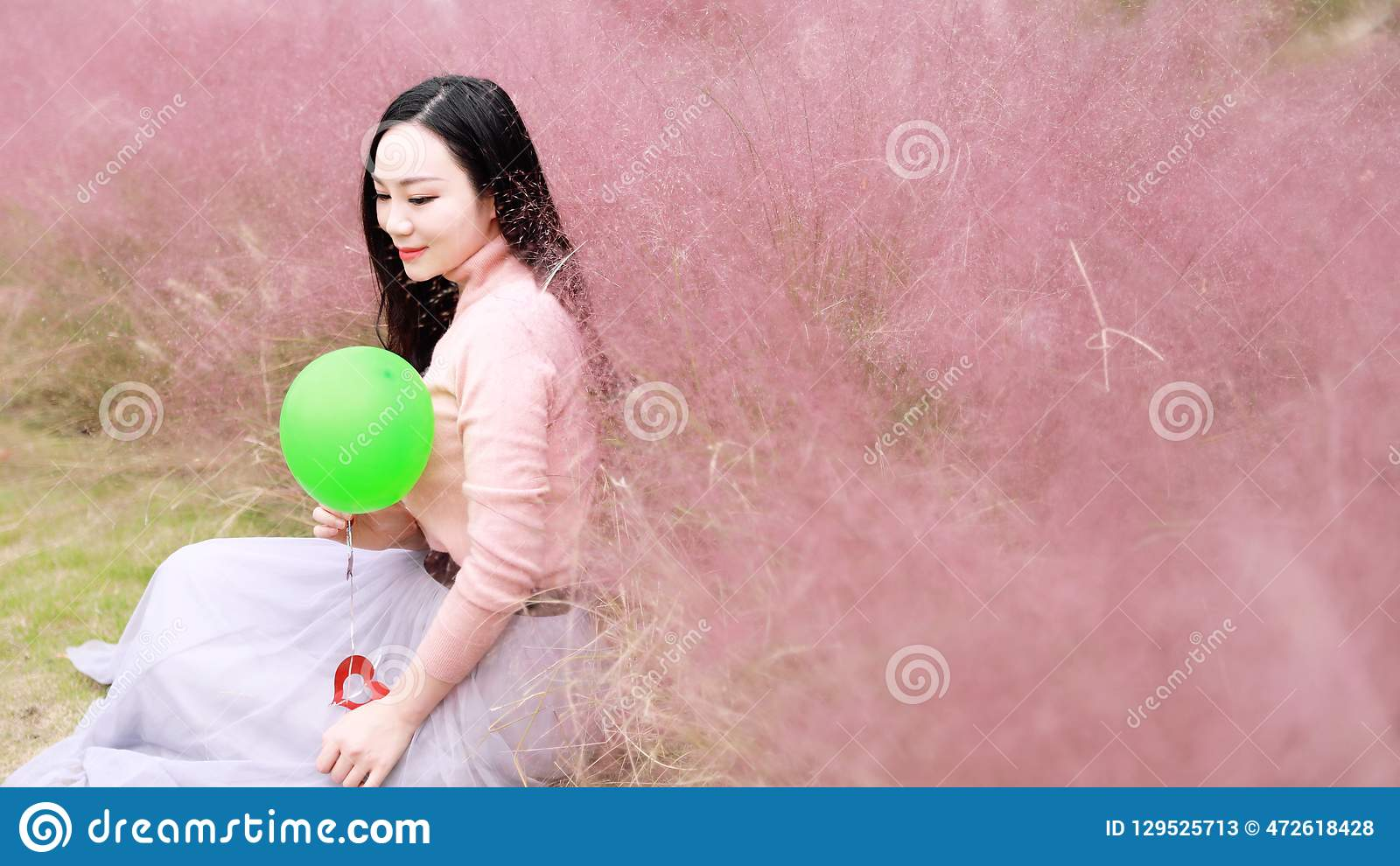 Happy Asian Chinese woman girl feel freedom dream pray flower field fall park grass lawn hope nature read book balloon red love