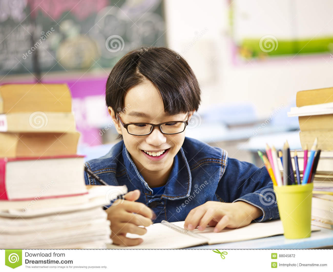 happy asian elementary school student studying in