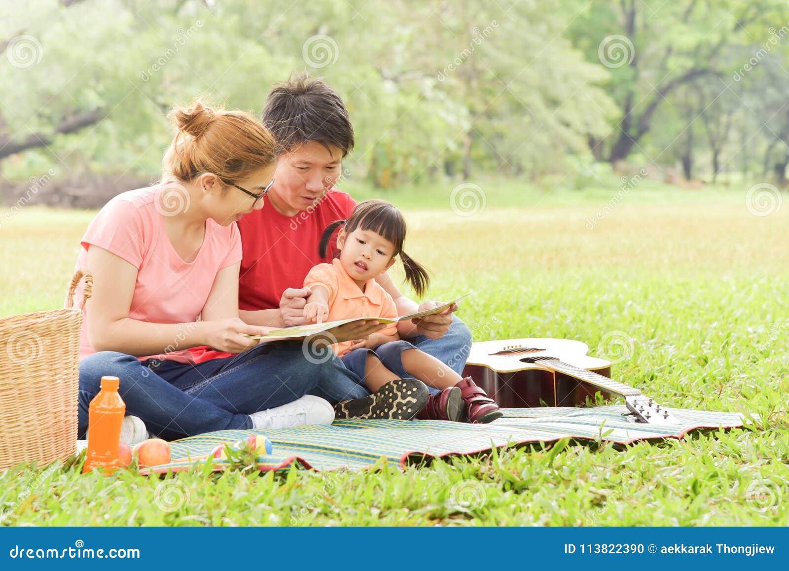 Happy Asian family having fun.