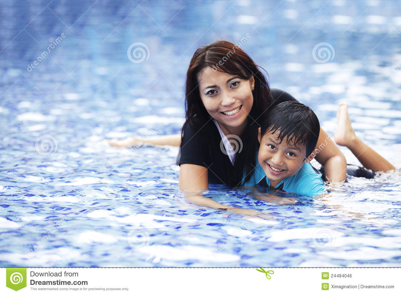 Happy asian family posing at swimming pool stock image for Family swimming pool