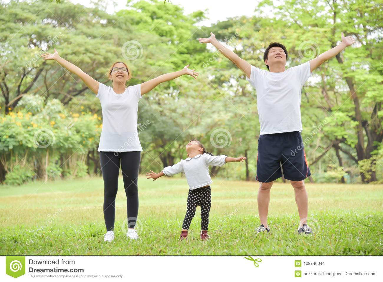Happy Asian family workout at the park.