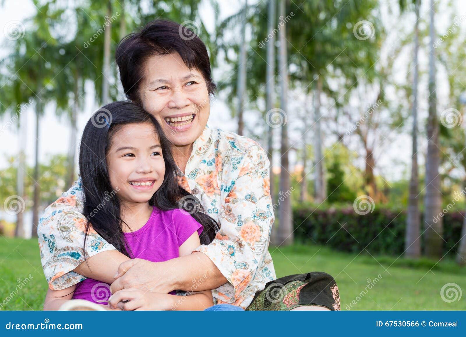 happy asian grandma and grandchild smiling stock photo image of