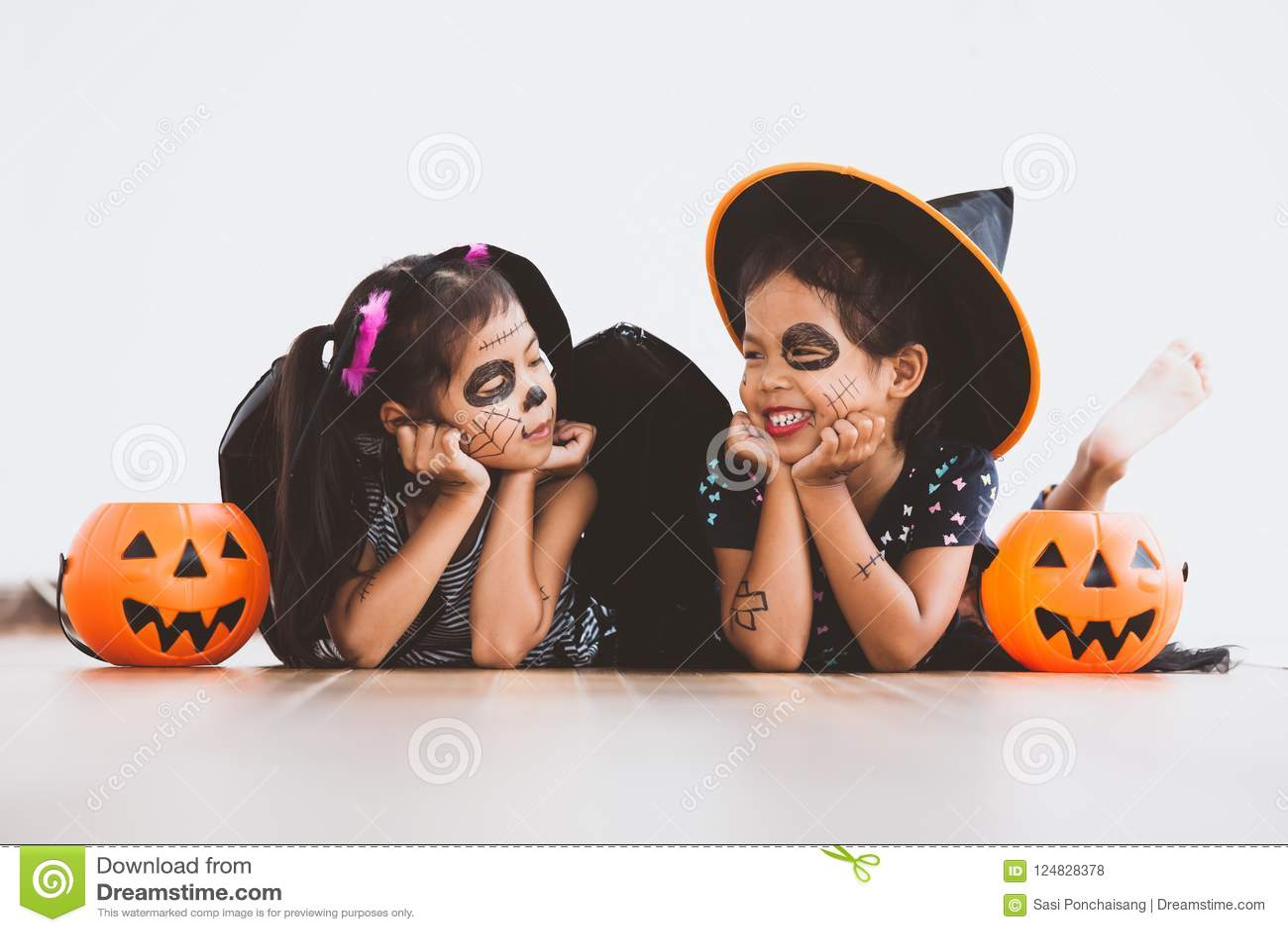 Happy asian little child girl having fun on Halloween celebration
