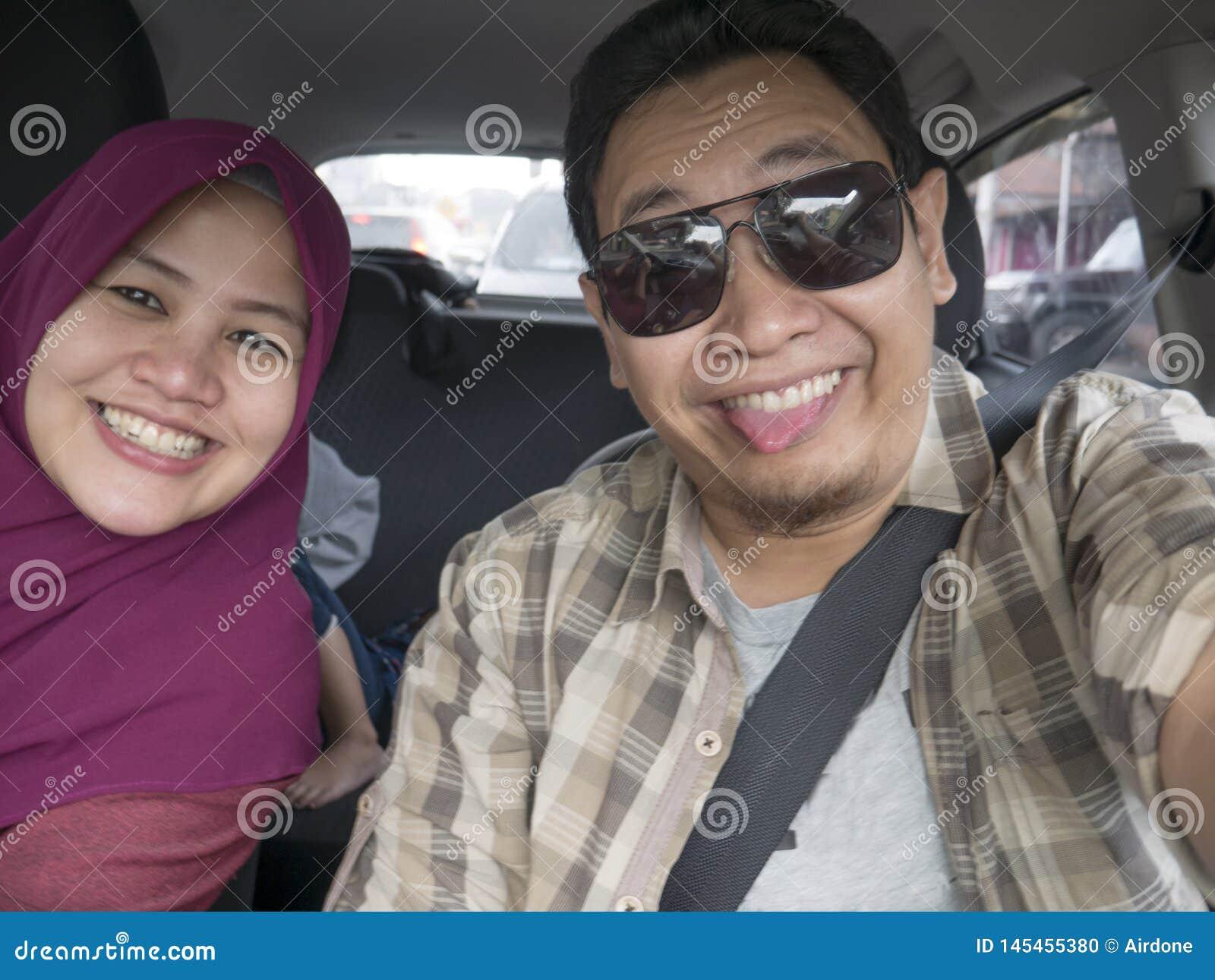 Happy Asian Muslim Family in Mudik Trip