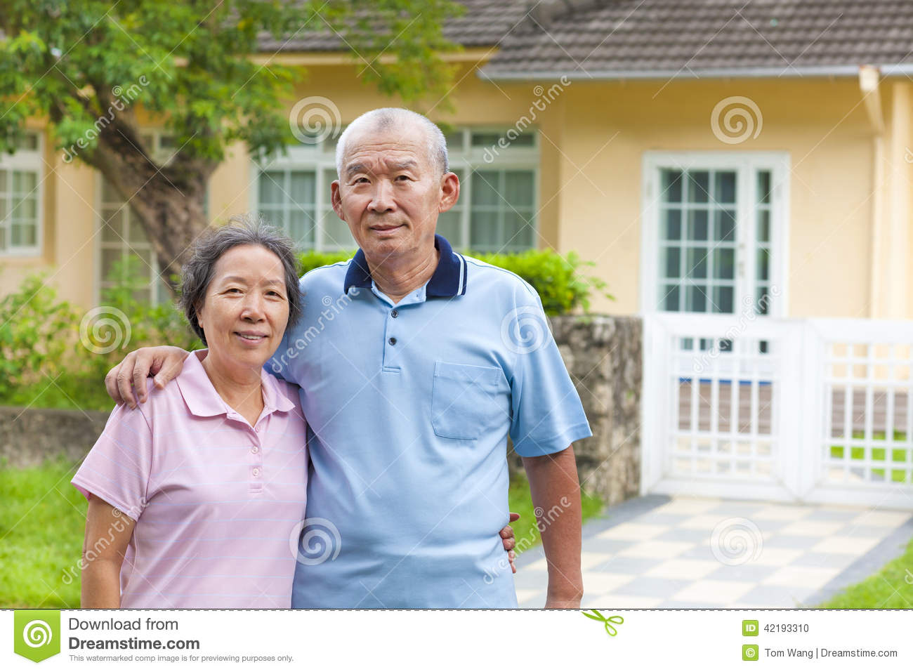 Happy Asian Senior Couple Standing In Front Of A House ... Happy Asian Family In Front Of House