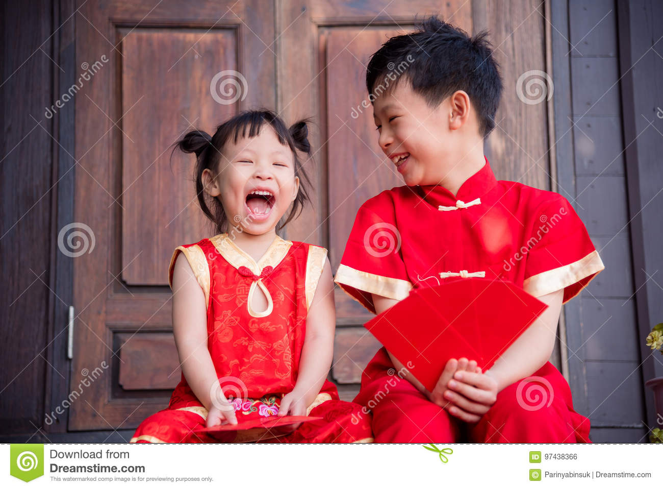 Happy asian siblings in chinese traditional costume