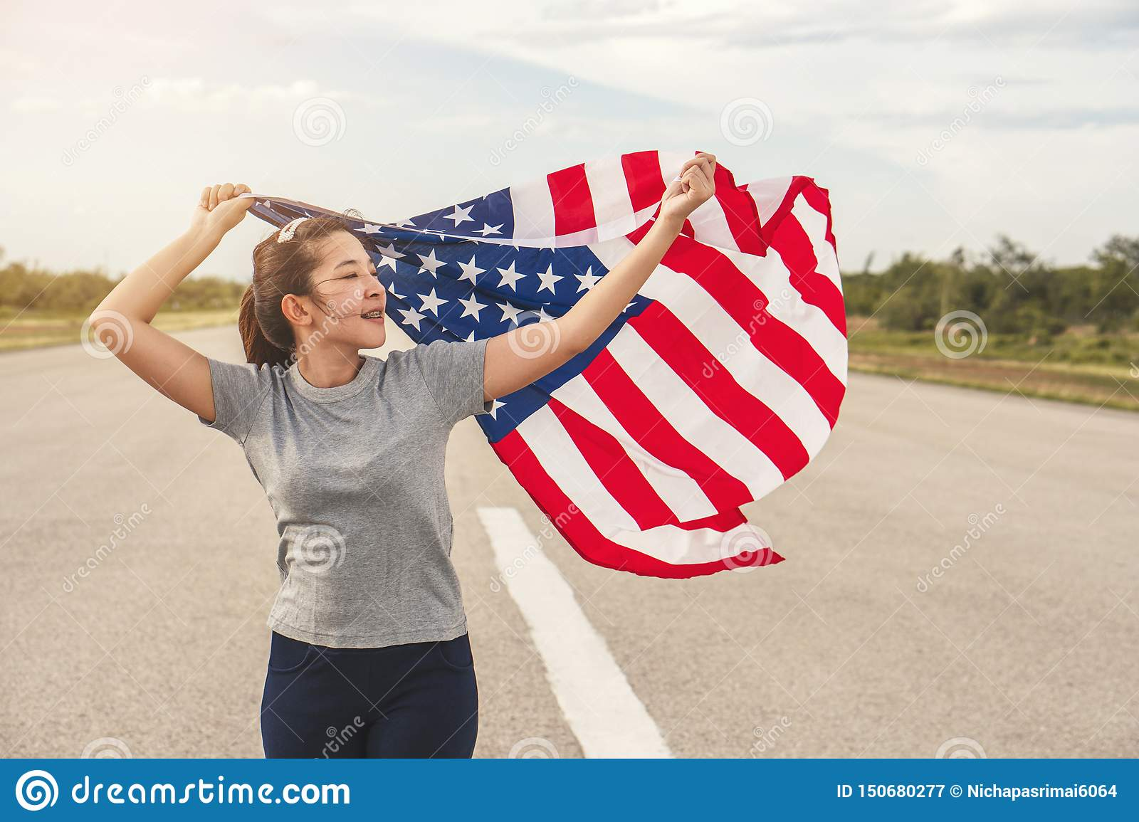Happy asian woman with American flag USA celebrate 4th of July