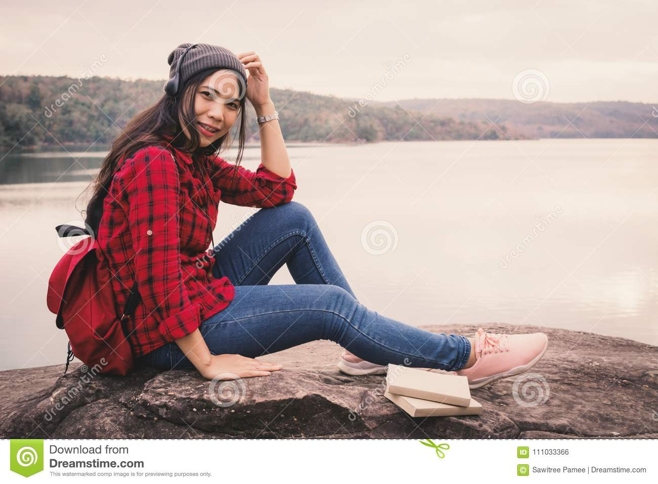 Happy Asian woman backpacker relaxing on holiday travel concept