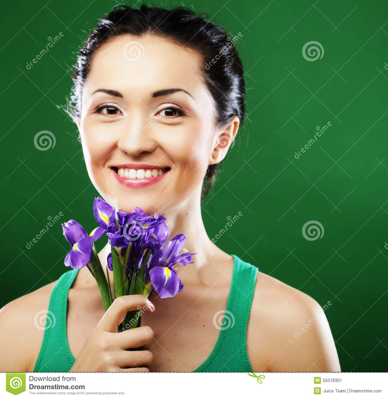 Happy asian woman holding a bouquet of irises