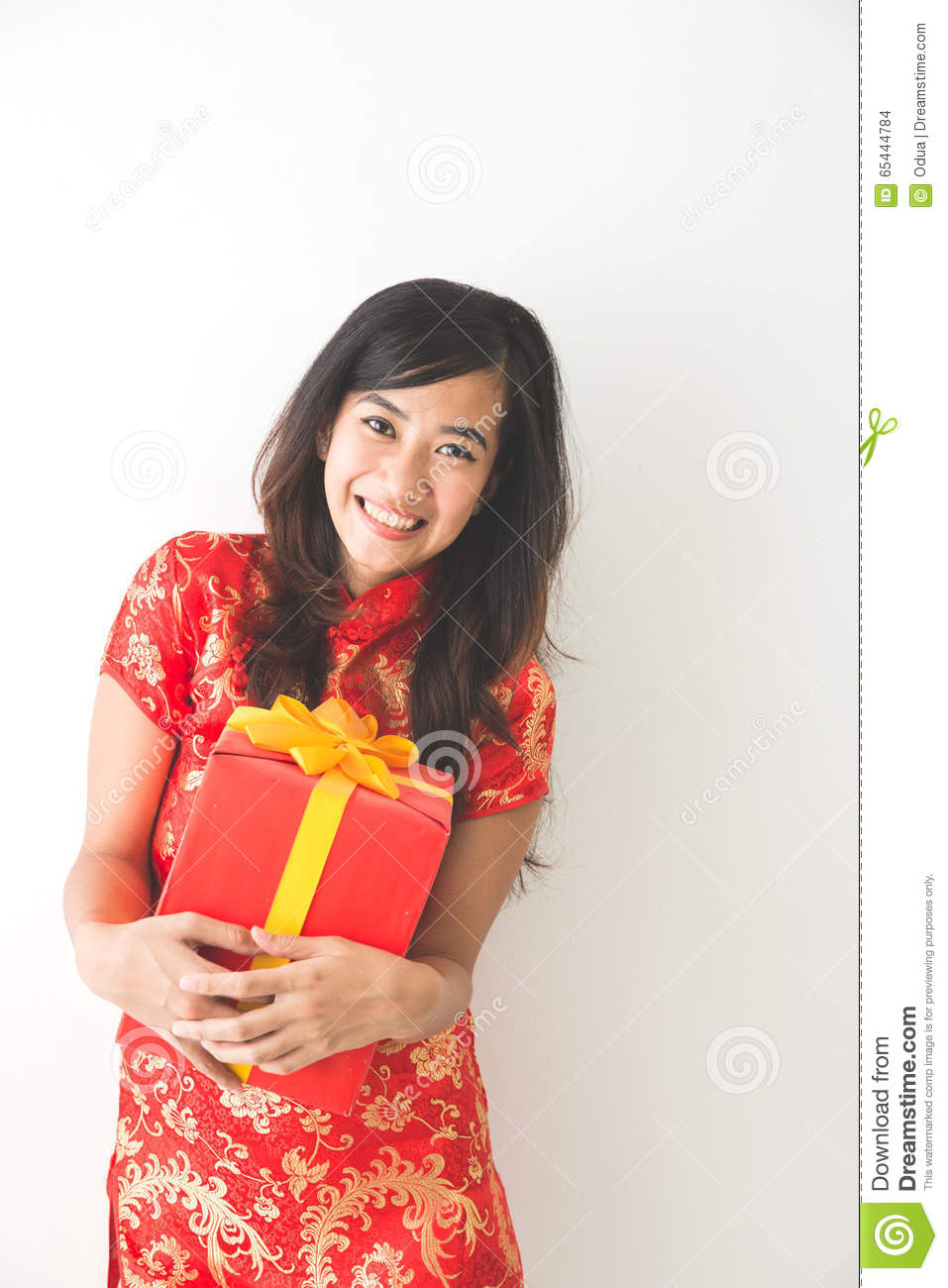 Happy Asian Woman Holding On Gift Box While Celebrating ...