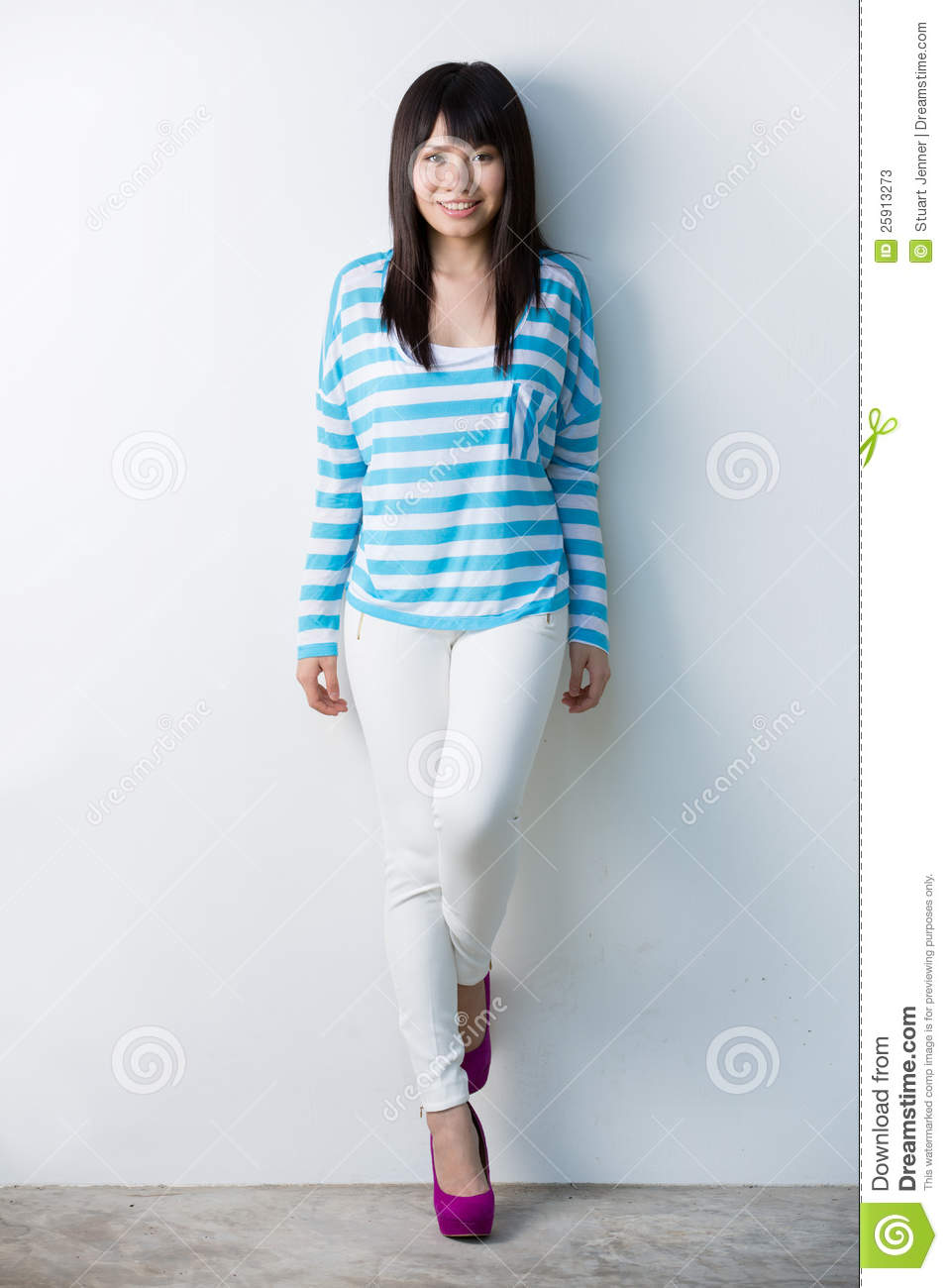 Happy Asian Woman Leaning Against Wall Stock Photos